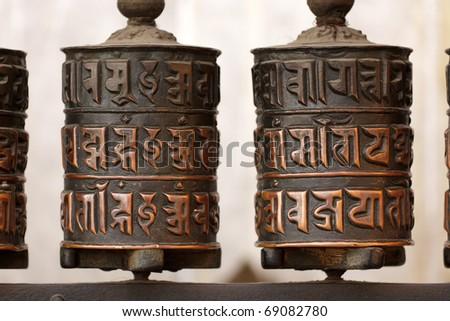 tibetan prayer wheels at monkey temple, Kathmandu, Nepal - stock photo