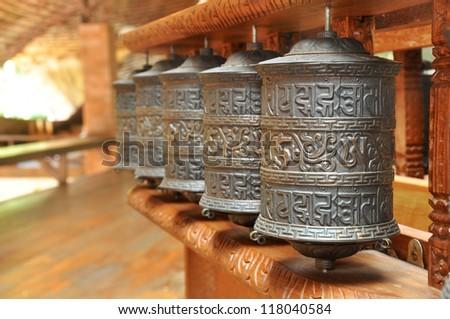 Tibetan prayer wheels in Buddhism temple - stock photo