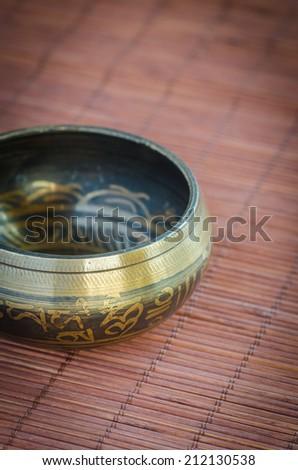 Tibetan singing bowl - stock photo