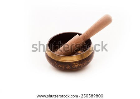 Tibetan singing bowl isolated - stock photo