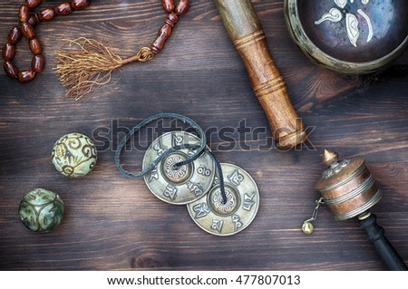 tibetian singing bowls,religious drums, beads and plates, view from above, asian copper music instruments for relaxation