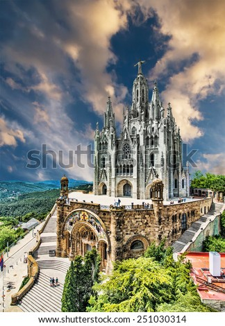 Tibidabo church on mountain in Barcelona with christ statue  - stock photo