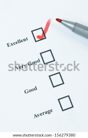 Tick box being marked by a red felt tip pen - stock photo