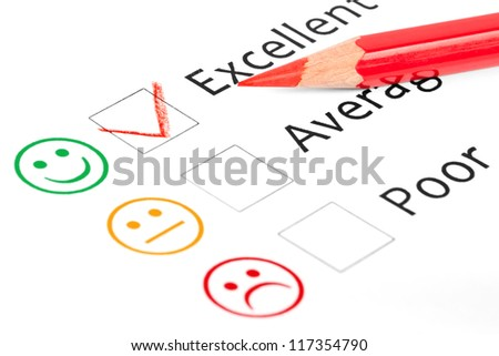 Tick placed in excellent check box on customer service satisfaction survey form - stock photo