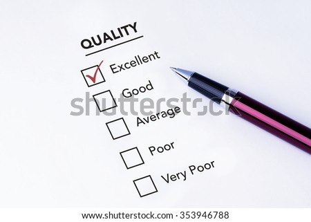 Tick placed in excellent check box on quality service satisfaction survey form with a pen on isolated white background. Business concept survey.