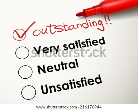 tick placed in outstanding check box with red pen over evaluation survey - stock photo