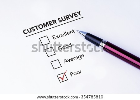 Tick placed in poor check box on customer service satisfaction survey form with a pen on isolated white background. Business concept survey.