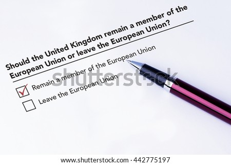 Tick placed in Remain a member of the European Union check box on European Union form with a pen on isolated white background. Brexit UK EU referendum concept