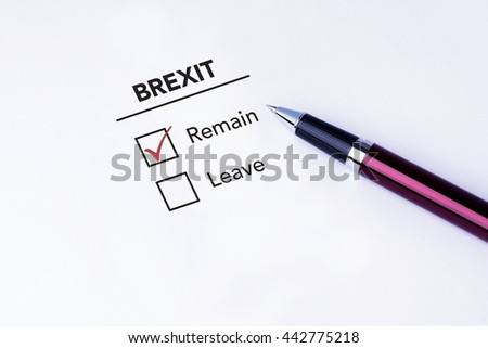 Tick placed in Remain check box on brexit form with a pen on isolated white background. Brexit UK EU referendum concept