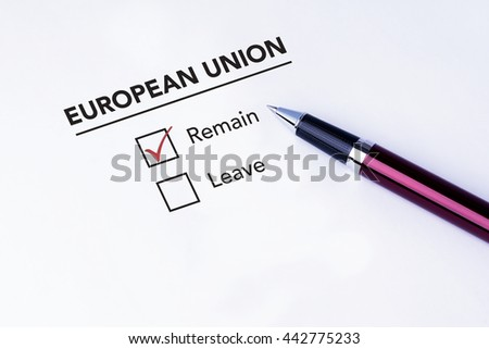 Tick placed in Remain check box on European Union form with a pen on isolated white background. Brexit UK EU referendum concept