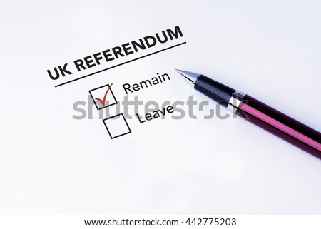 Tick placed in Remain check box on UK Referendum form with a pen on isolated white background. Brexit UK EU referendum concept