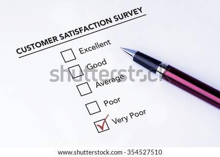 Tick placed in very poor check box on customer service satisfaction survey form with a pen on isolated white background. Business concept survey.