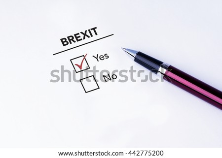Tick placed in Yes check box on Brexit form with a pen on isolated white background. Brexit UK EU referendum concept