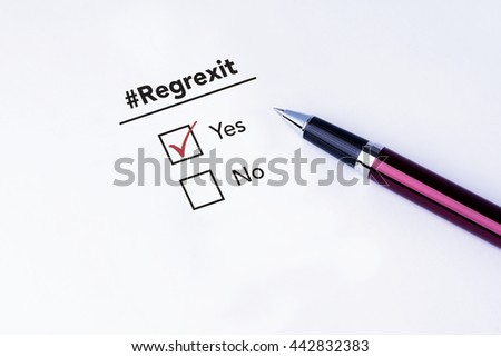 Tick placed in Yes check box on #Regrexit form with a pen on isolated white background. Brexit UK EU referendum concept