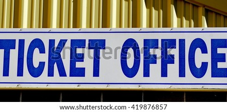 Ticket office sign displayed outdoors.