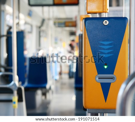 Ticket validator in a tram closeup. Dresden, Germany, tram inside, nobody. - stock photo