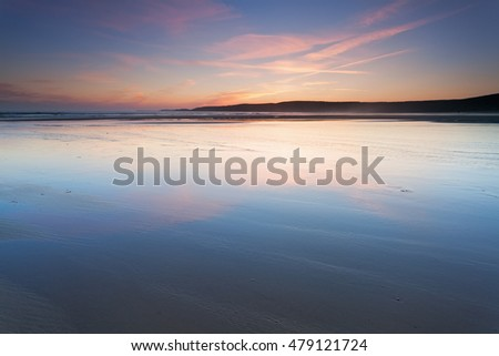 Tidal beach at sunset. Freshwater West, Pembrokeshire, Wales