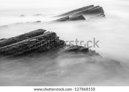 Tidal Rocks Long Exposure - stock photo