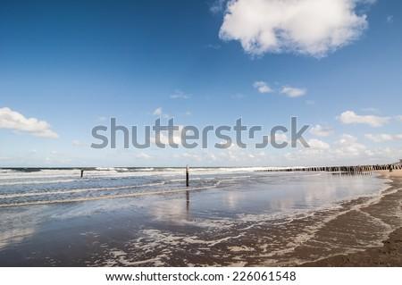 Tide on the beach of Domburg, Zeeland, Netherlands - stock photo
