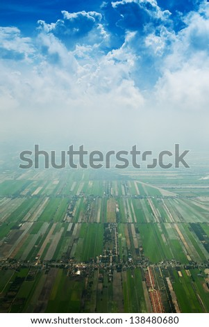 tidy square - view over the early summer green fields from the air,Thailand - stock photo