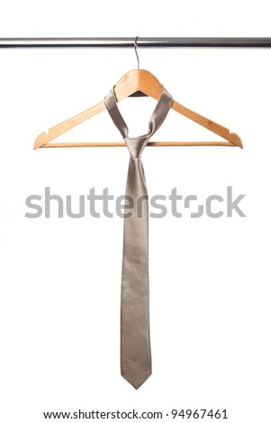 tie and coat hanger isolated on white - stock photo