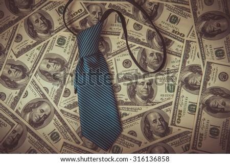 Tie and one hundred dollars