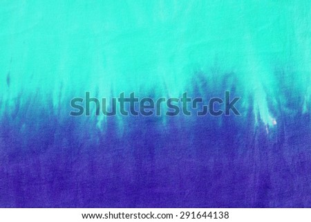 tie dyed pattern on cotton fabric abstract background.  - stock photo