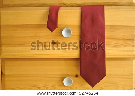 Tie Hanging out of Chest Drawer