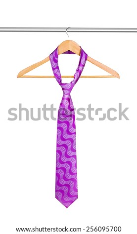tie on a hanger on a white background - stock photo