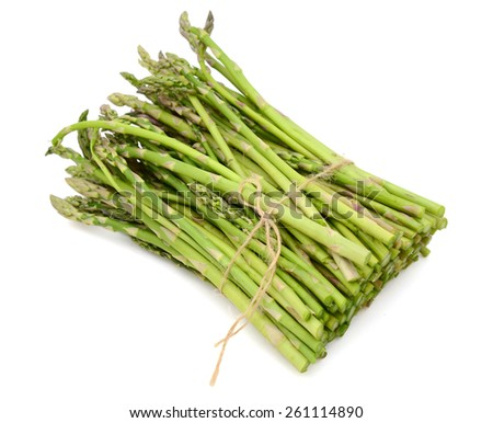 tied green asparagus on white background  - stock photo