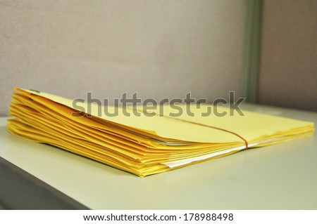 Tied Yellow Folders On The Table - stock photo