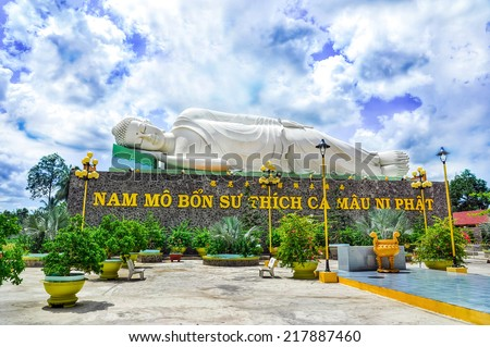 TIEN GIANG, VIETNAM - JULY 12, 2014: Sleeping Buddha statue located in the famous Vinh Trang pagoda in My Tho city, Tien Giang province, Vietnam.