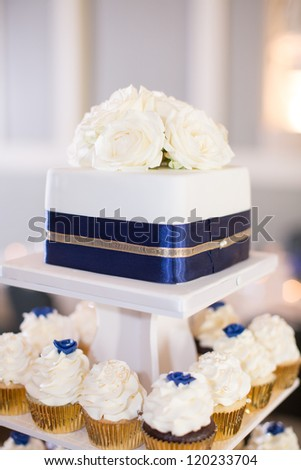 Tiered Cupcakes and Cake - stock photo