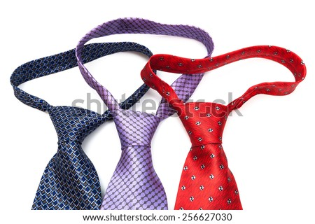 ties knotted on a white background - stock photo