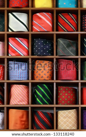 Ties on the shelf of a shop. Background - stock photo