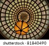 Tiffany's stained glass ceiling dome with chandelier at the Chicago Cultural Center - stock photo