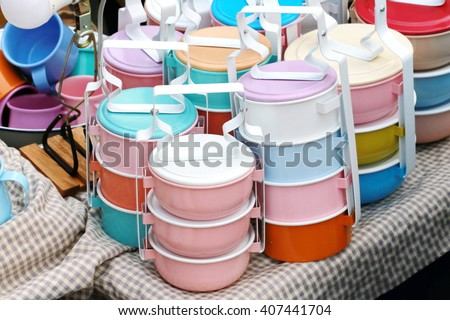 tiffin carrier, Still life with colorful retro food carrier on wood table background  - stock photo