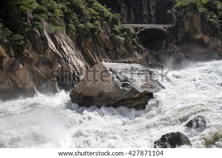 Tiger Leaping Gorge is a canyon on the Yangtze River, locally called the Golden Sands River, located 60 km north of Lijiang City, Yunnan in southwestern China. - stock photo