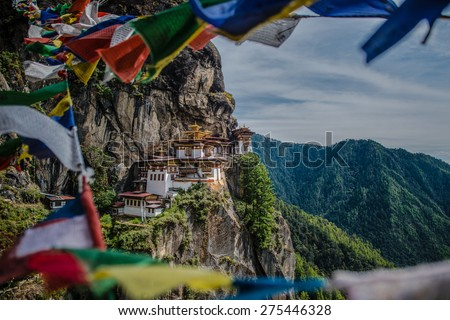 Tiger's nest Temple ,Taktsang Monastery with prayer flags view.  One of the most beautiful temple in the world. Located in Paro city,Bhutan. - stock photo