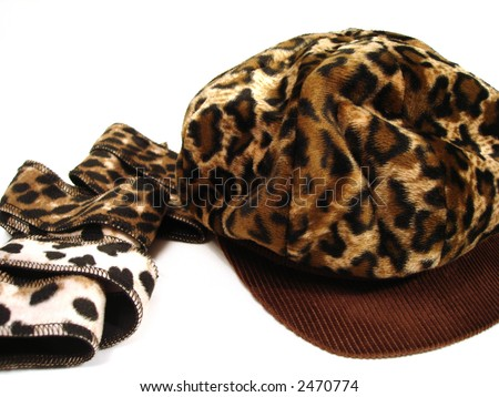 tiger scarf and hat over white background