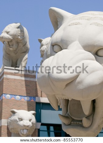 Tiger Stadium home of Major League Baseball's Detroit Tigers is in Detroit Michigan USA and it has many statues of Tigers in front on the stadium these are a few of them - stock photo