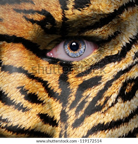 Tiger stripes pattern on man face - stock photo
