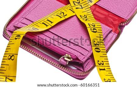 Tight Budget Concept with Open Wallet Squeezed by a Measuring Tape. - stock photo