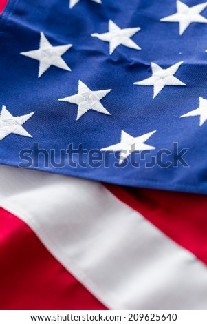 Tight closeup of the stars and stripes of an American Flag.