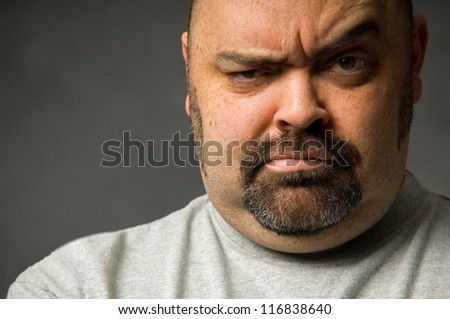 Tight crop of serious man's face - stock photo
