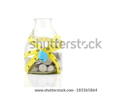 Tight financial budget concept with coins, measurement tape and padlock isolated on white background - stock photo