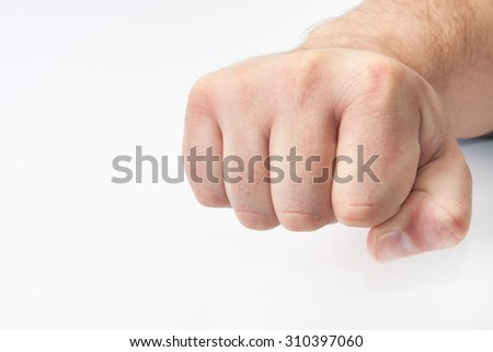 Tightly closed fist on the white background.
