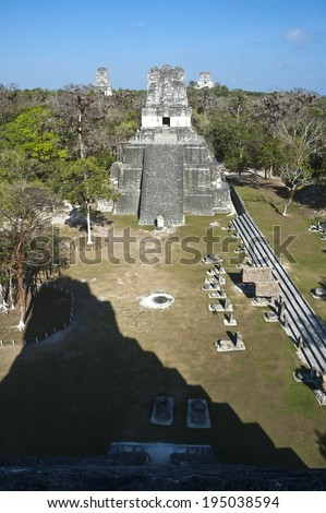 Tikal guatemala pyramid ancient old mayan stone tourist sky maya civilization travel architecture tourism culture forest american nature green tropical park construction - stock photo