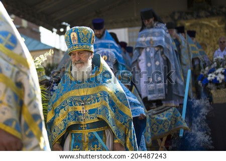 TIKHVIN, RUSSIA - JULY 9, 2014: Unidentified participants Orthodox divine Liturgy on the occasion celebrations of the 10th anniversary of the return of the Tikhvin icon of the Mother of God.