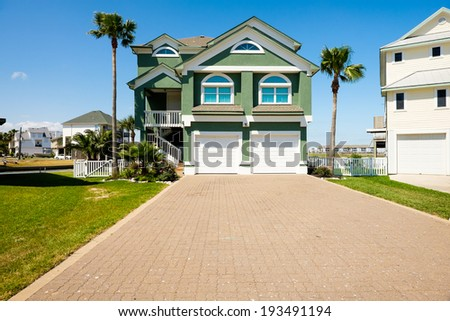TIKI ISLAND, TEXAS USA - MAY 6, 2014: The village of Tiki Island, located on a small peninsula in Jones Bay in Galveston County, is a popular coastal community containing beautiful waterfront homes.